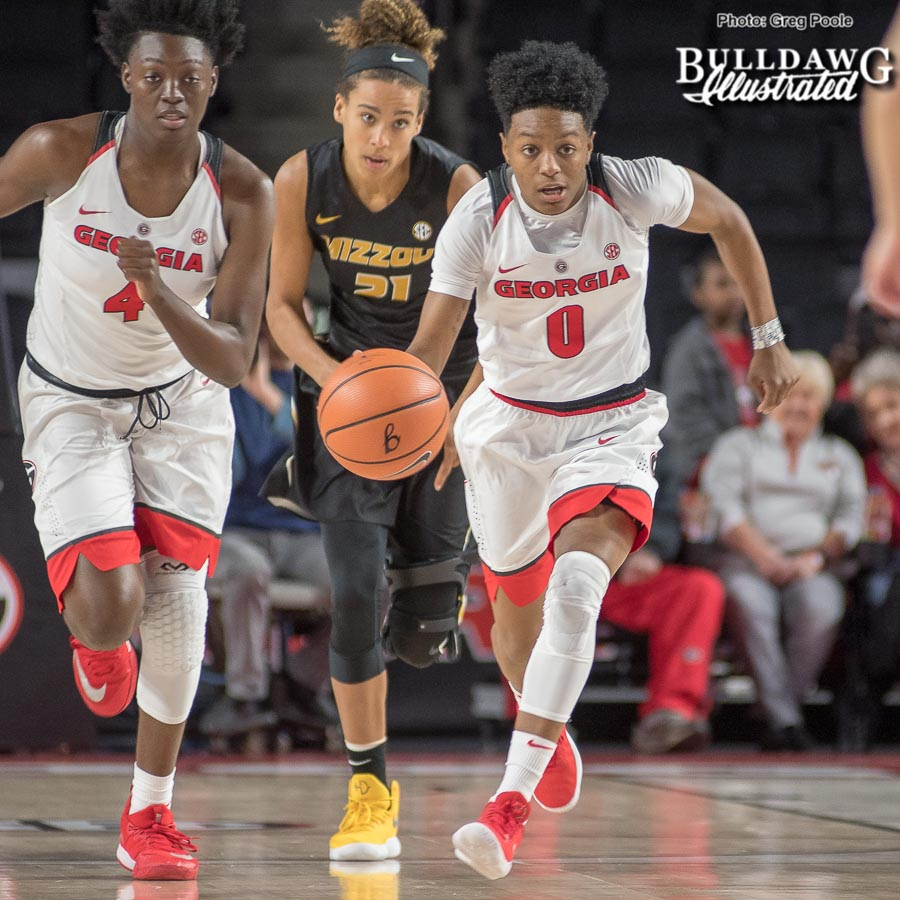 Georgia women's basketball sophomore guard Taja Cole (0) drives the ball down the court in the Lady Bulldogs' game versus Missouri.