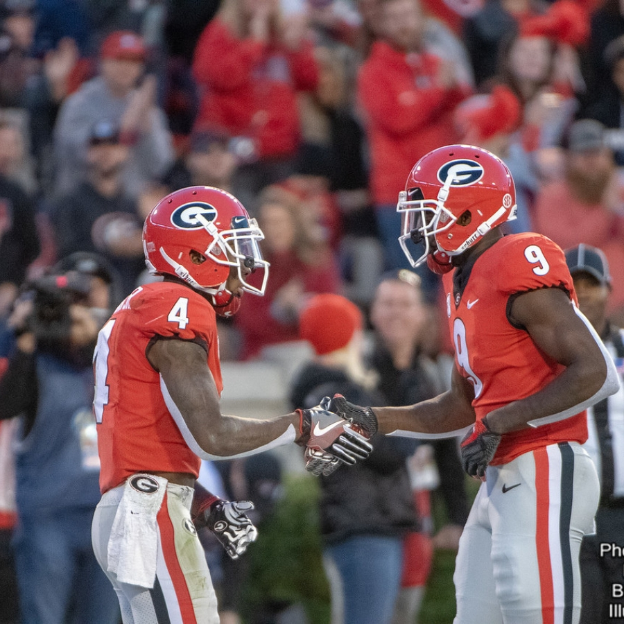 Mecole Hardman (4) and Jeremiah Holloman (9)