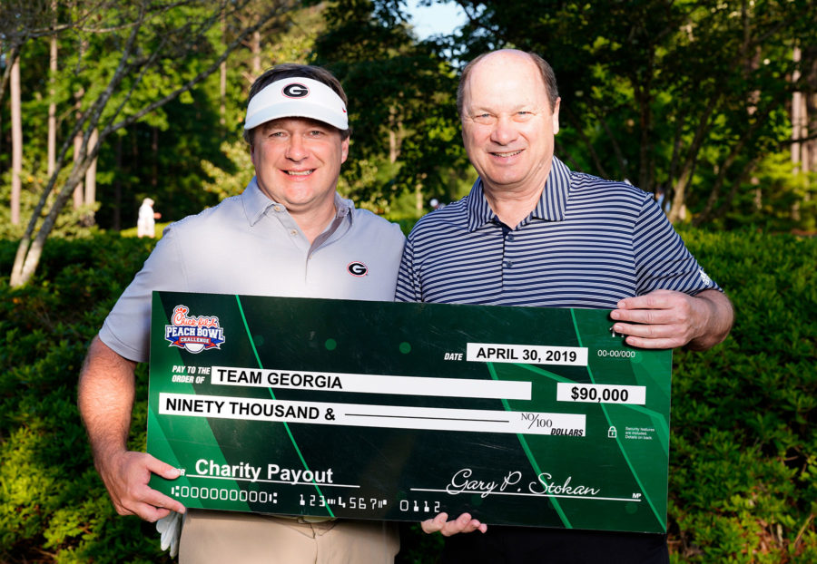 Kirby Smart Presented with check from Chick-fil-A Peach Bowl Challenge  (Photo: Georgia Sports Communications)