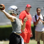 Jake Fromm throws as Sam Madden looks on