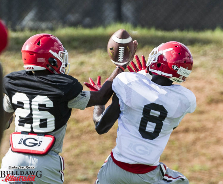 Tyrique McGhee (26) bats the ball away from Riley Ridley (8)