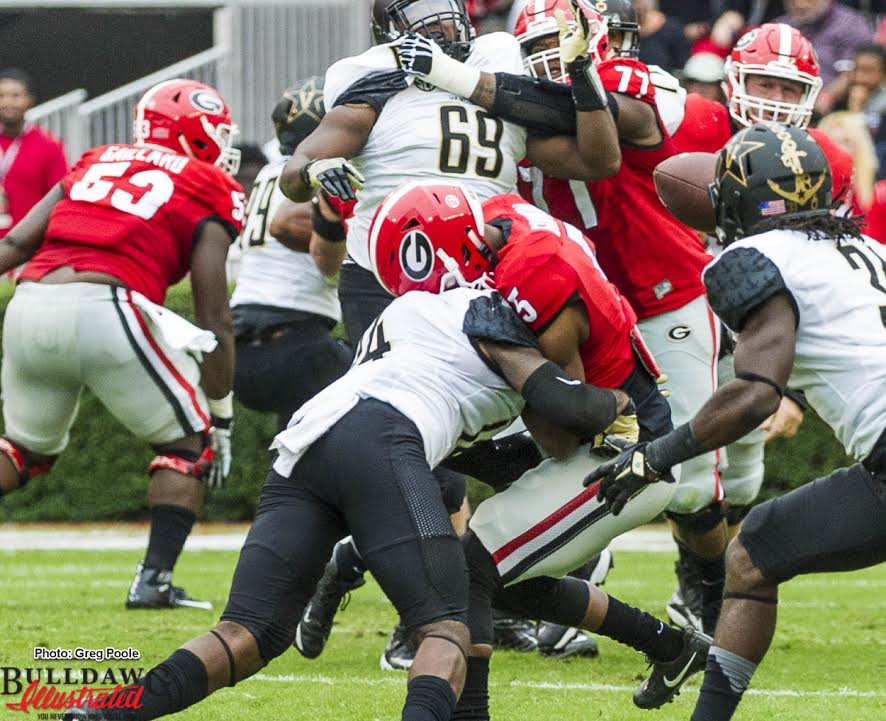 Terry Godwin (5) has his clock cleaned by Vandy Safety Ryan White (14)