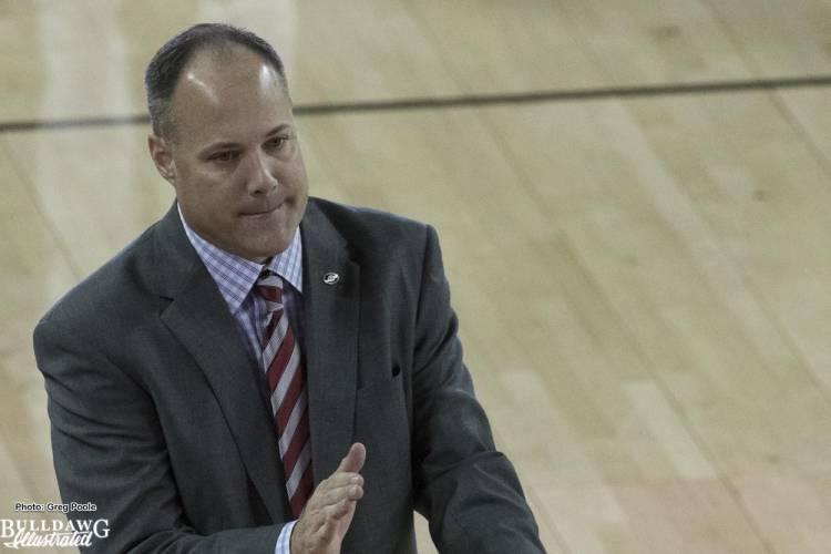 Coach Mark Fox motivates the team during a timeout.