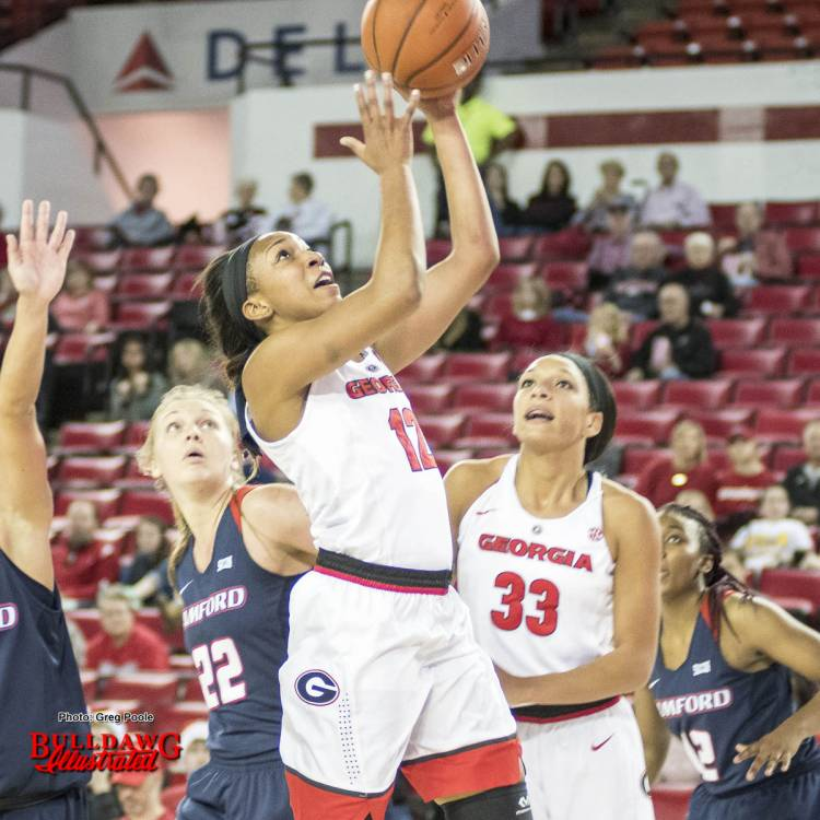 Haley Clark (12) shoots a layup as Mackenzie Engram (33) watches closely in case she needs to rebound.