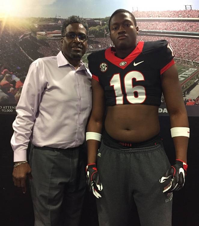 Brandon Henderson (right) with Georgia Defensive Line Coach Tracy Rocker (left) (photo from Brandon Henderson - Twitter)