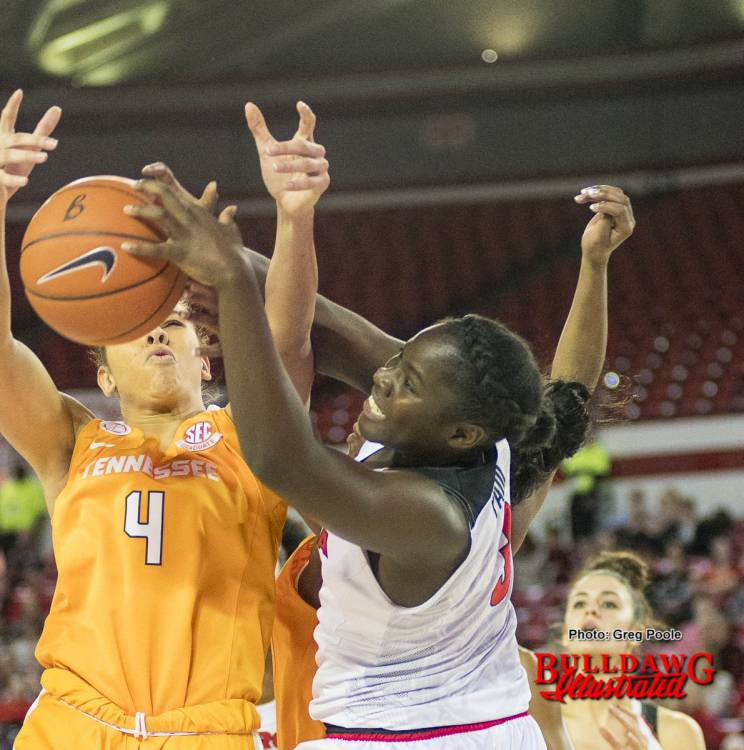 Stephanie Paul fights for an offensive rebound