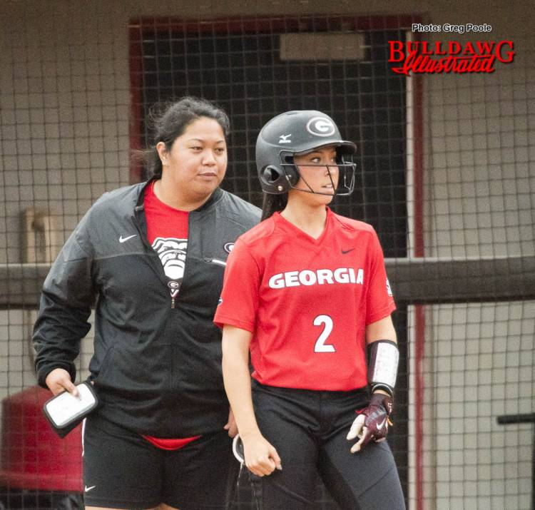 First base coach Tina Iosefa gives instructions to Justice Milz