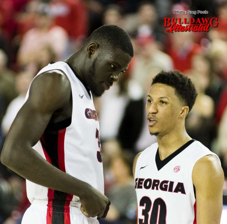 Derek Ogbeide and J.J. Frazier (30) in the closing seconds of the game