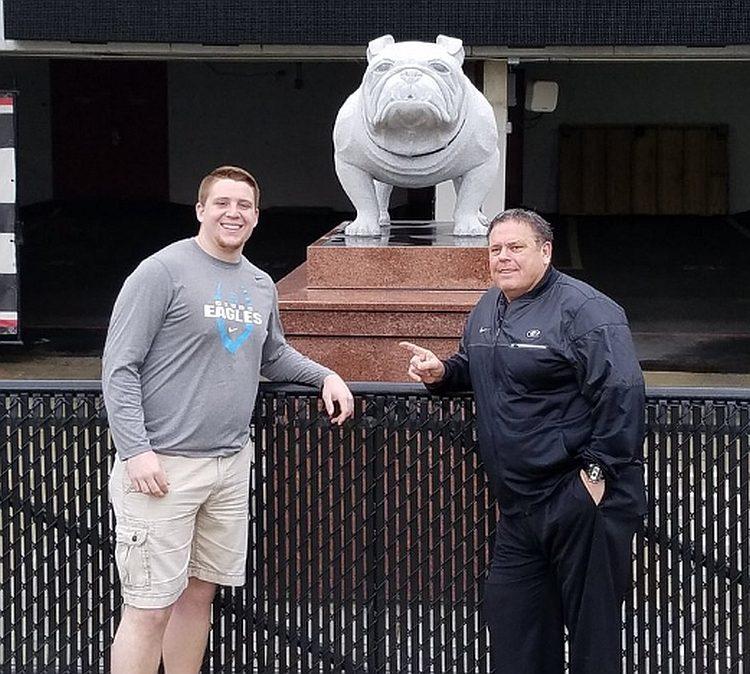 Ollie Lane(left) with UGA OL Coach Sam Pittman (right) (photo from Ollie Lane - Twitter)