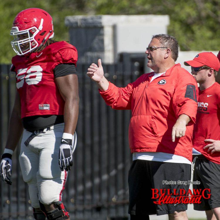 Coach Sam Pittman instructs Pat Allen in a drill. April 4, 2017