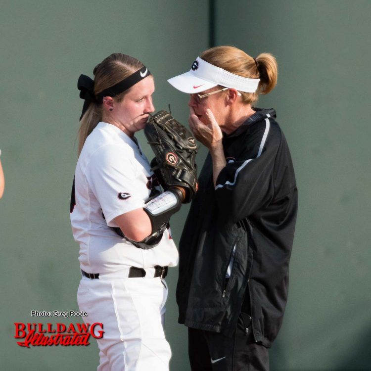 Coach Lu Harris-Champer talks with pitcher Kylie Bass prior to making a change on the mound