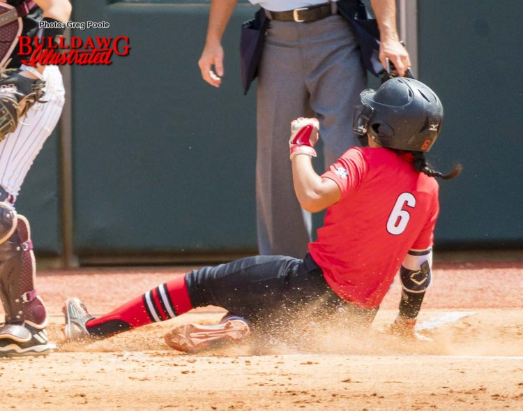 Sydni Emanuel slides into home plate
