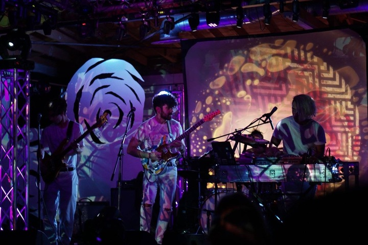 Moon Ensemble perform in front of trippy visuals