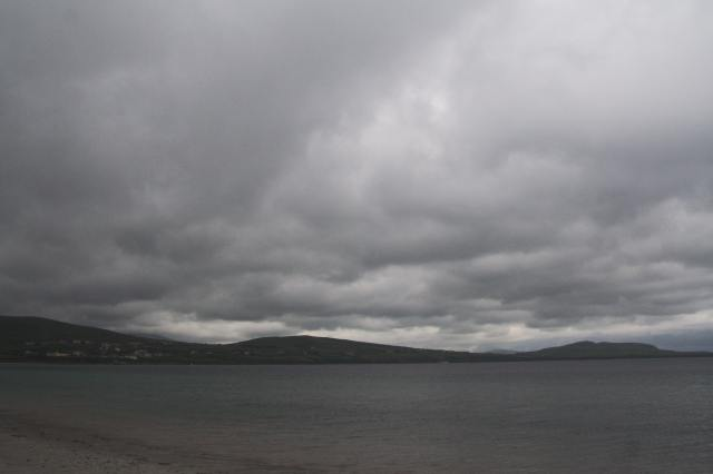 Darkened skies over an Irish beach.