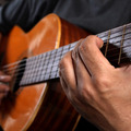 Playing acoustic guitar lg big square