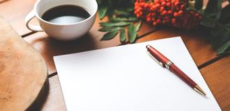 Blank paper with pen and coffee cup on wood table 6357 listing