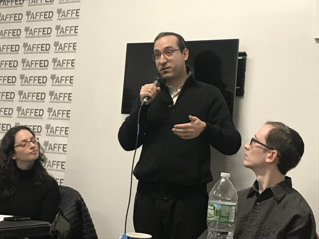 Rabbi Yossi Newfield at Repair the World in Crown Heights during a Hannukkah party and panel on secular education at certain ultra-Orthodox Jewish schools.