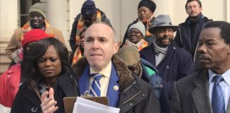 City Councilman Mark Treyger in front of City Hall rallying for legislation that would allow Russian- and Haitian Creole-speaking translators inside poll sites.