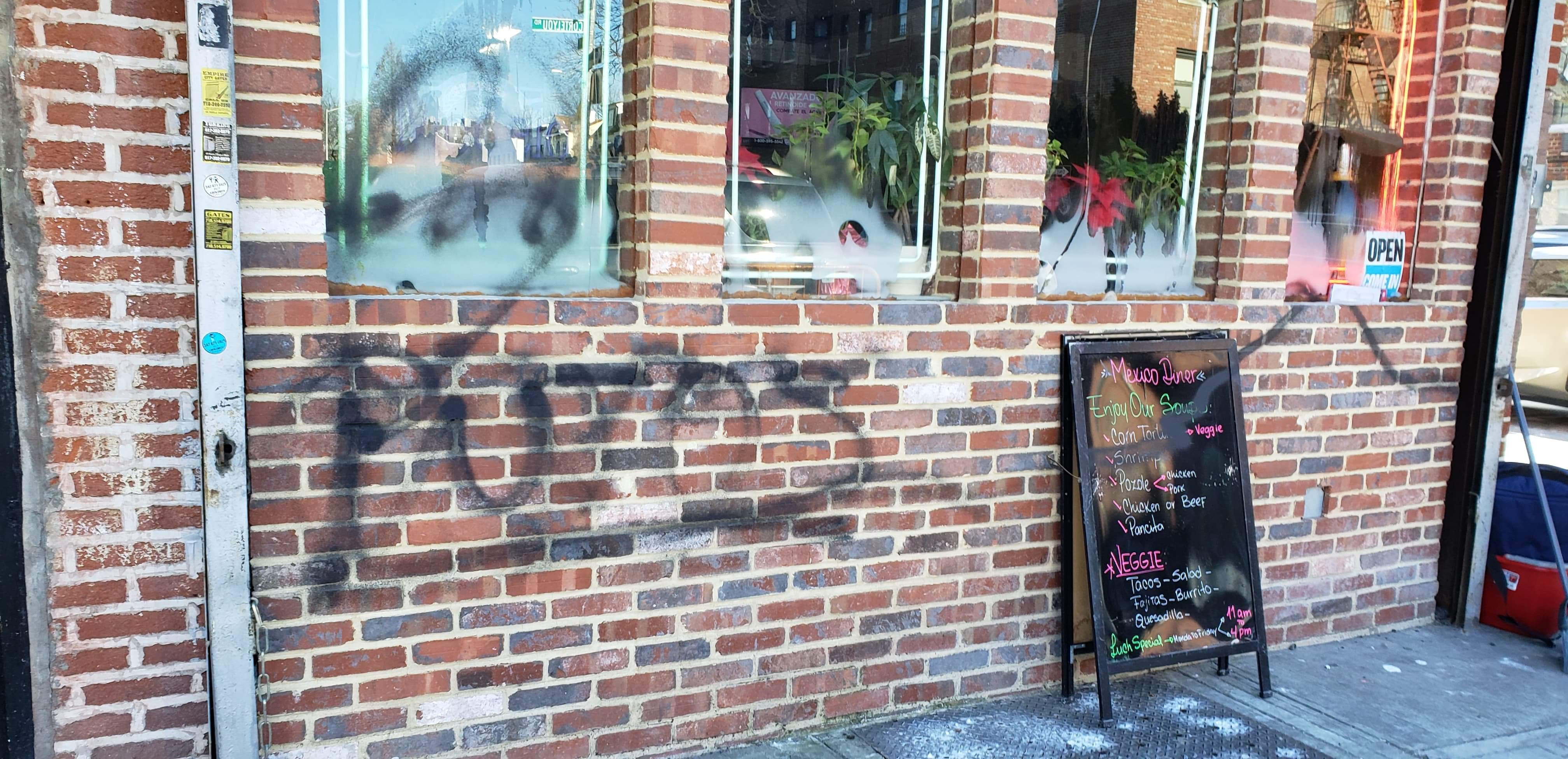 "Unidentified person graffitied the words ""Putos"" outside Mexican Diner in Ditmas Park (Photo credit: Je Suis Encrateia)"