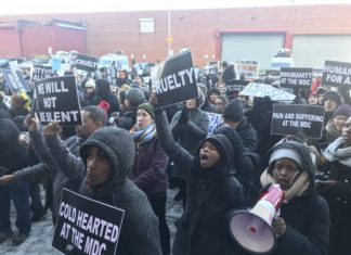 Protesters outside of the Metropolitan Detention Center in Sunset Park rally after inmates at the federal facility go without heat and lights following an electrical outage. (Kadia Goba/Bklyner)