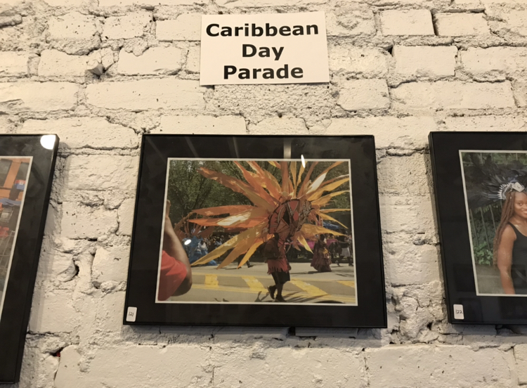 Snapshots of the West Indian Labor Day Parade at the photo exhibit on living in Crown Heights. The gallery is curated by the Nostrand Avenue Improvement Association (Photo: Kadia Goba/Bklyner)