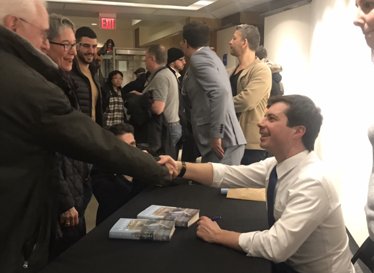 Pete Buttigieg signing books after his talk inside the Dr. S. Stevan Dweck Cultural Center at the Brooklyn Public Library (Photo: Kadia Goba/Bklyner)