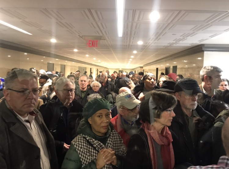 Crowd gathers outside of a the NYC Dept. of Planning hearing room ahead of the 960 Franklin Avenue Rezoning scoping meeting. Photo: Kadia Goba/Bklyner