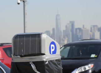 New parking meters installed at the 58th Street Pier in view of Manhattan. (Photo: Todd Maisel/Bklyner)