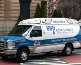 A Kingsbrook ambulance heads toward the hospital after picking up someone from a bus on Nostrand Avenue, March 18, 2020. Photo: Ben Fractenberg/THE CITY