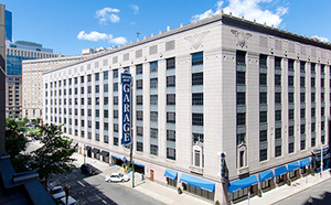 Motor mart garage 201 stuart street bay village boston parking retail art deco cim group sale