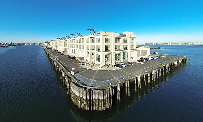 88 black falcon avenue seaport district boston office building the davis companies acquisition