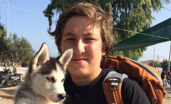 pet adoption articles: A young Syrian refugee and his pup walk 500km to a new life
