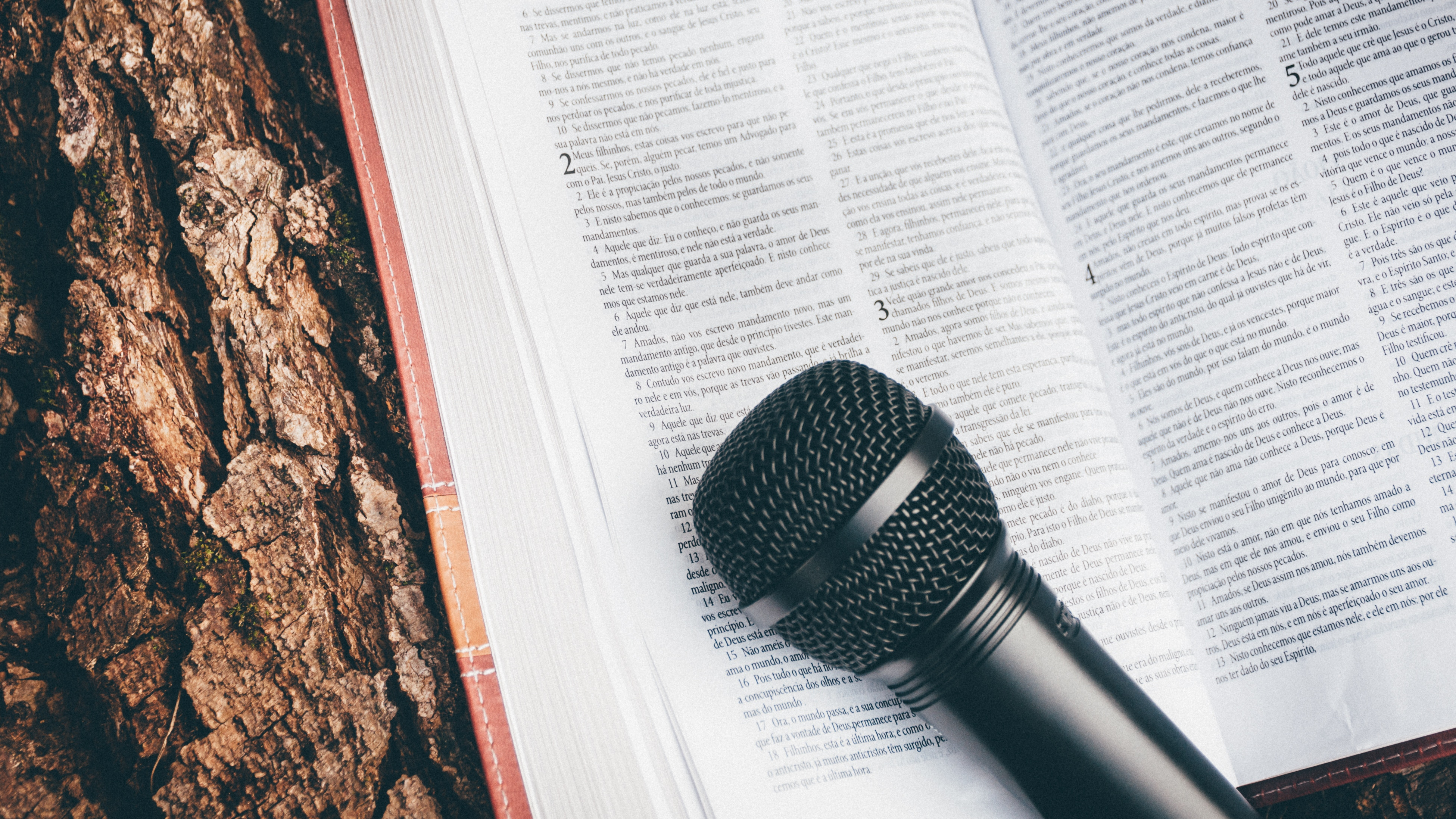 microphone lying on book