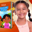 Menina negra ao lado do livro Folclore no Sítio