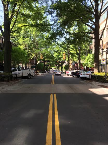 """Driving across Main Street, Greenville, SC on my way to work at CoWork Greenville. Main Street, Greenville, SC is ranked one of the top Main Streets in the US by Parade Magazine (2014) and Travel & Leisure (2012).""Matthew Cook, Digital Producer"