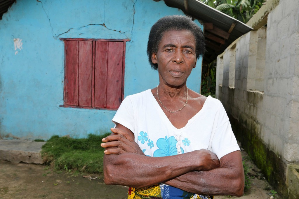"Florence Abuah, mother of seven and grandmother of 10, says ""after the crisis we began planting crops to earn our daily bread. We have nothing else to meet our needs."" She says farmers in Rumuekpe grow cassava, maize, and other vegetables like yams. She says the government should use money it earns from exporting oil to ""give us a school, a health center, good roads, and water."" Photo by George Osodi / Panos for Oxfam America."