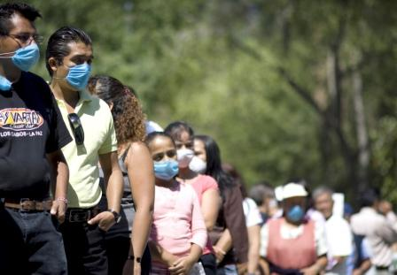 People wait outside a mobile clinic to test for signs H1N1 virus, formerly referred to as swine flu, in Mexico City on April 30, 2009. REUTERS/Jorge Dan (Mexico Health Society), courtesy www.alertnet.org.