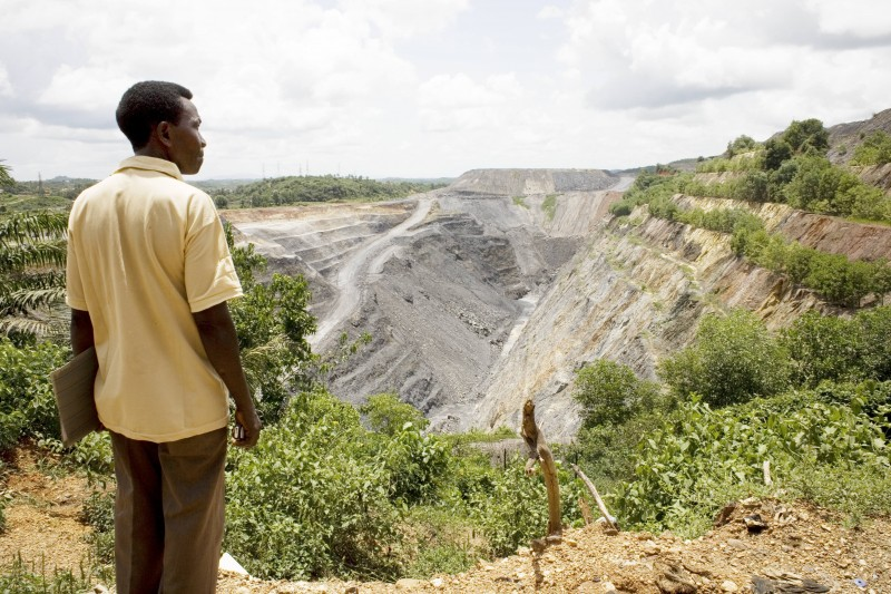 Godfried Ofori, a member of the Concerned Citizens Association of Prestea, Ghana, looks out over an open pit at the Bogoso/Prestea gold mine. Photo: Jane Hahn / Oxfam America
