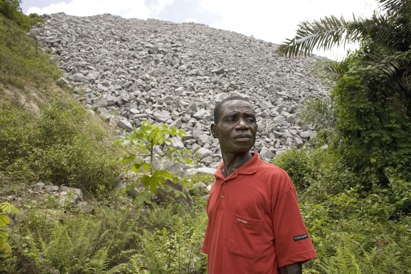 Waste rocks had buried almost all of James Sarpong's oil plams when I met him in 2007. Now he is without a home. Photo by Jane Hahn/Oxfam America