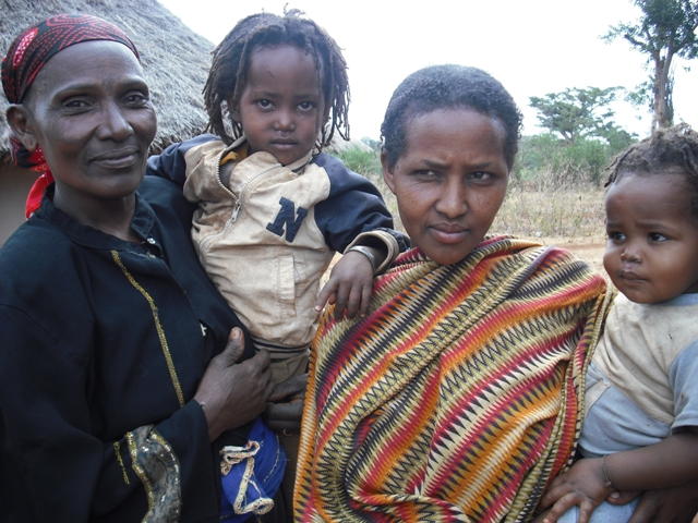 Loko Dadacha, on the left, stands with family members in her village of Gutu Dobi.
