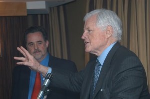 Oxfam's Raymond C. Offenheiser listens as the late Senator Edward M. Kennedy speaks at an event in Washington, DC, in February 2006. Photo by Christopher O. Banks