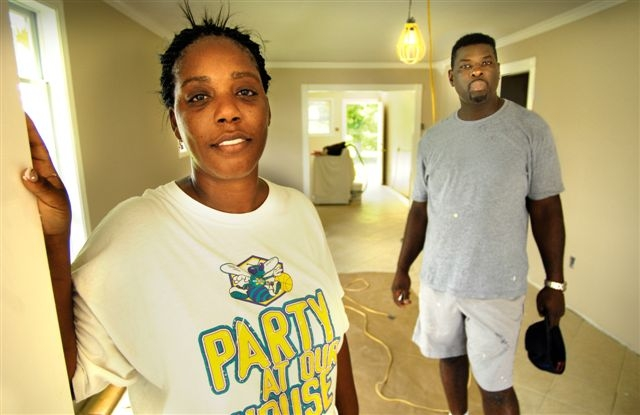 In the year following Hurricane Katrina, Cleo and Martin Sylvester lived in a FEMA trailer while they put together the financing they needed to rebuild their own home. Photo by Steve Thackston/Oxfam America