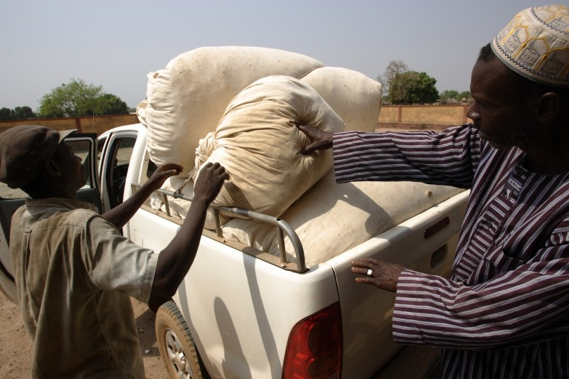 Cotton famers load a truck in Sibirila, Mali. Photo by Rebecca Blackwell/Oxfam America