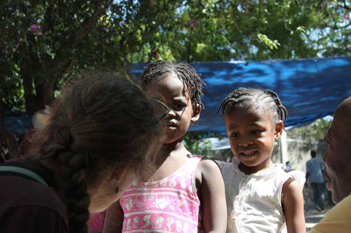 Coco McCabe interviews children at a camp for displaced people in Port-au-Prince