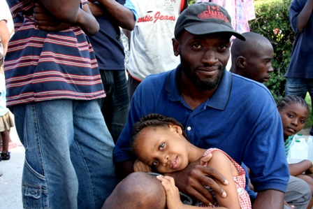 Andy Charles Etienne and his daughter Christina at a camp for displaced people in Haiti. Photo by Liz Lucas/Oxfam America