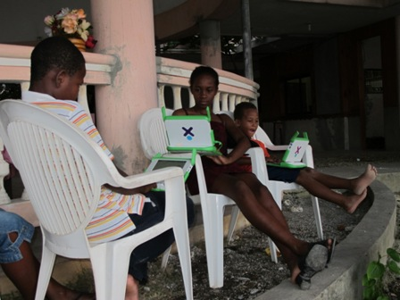 Students in Petite Riviere de Nippes, Haiti, are participating in a program that provides them with laptops.