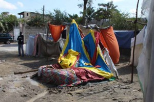 A collapsed tent after a night of rain in Port-au-Prince. Photo: Kenny Rae / Oxfam America