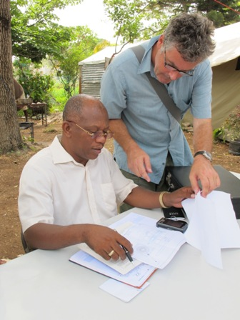 Oxfam's Kenny Rae discusses plans with the Rev. Jean Jacques Frederick. Photo: Coco McCabe / Oxfam America