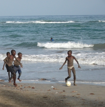 Boys play soccer on the beach in Jacmel, the town where one of Sophia Lafontant's grandmothers lives. Photo: Sophia Lafontant