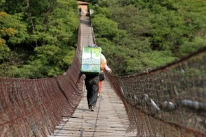 Although scary to cross, this bridge was the only direct link to the road to the nearest large town for the farmers in Xinacati II. Photo by James Rodriguez/Oxfam America.